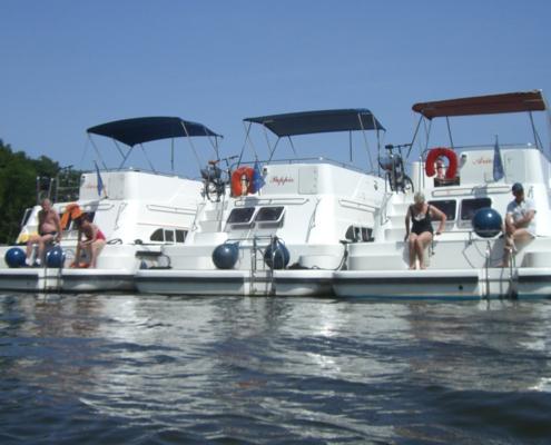 Zum Baden im See ankern Hausboot mieten Mecklenburger Seenplatte